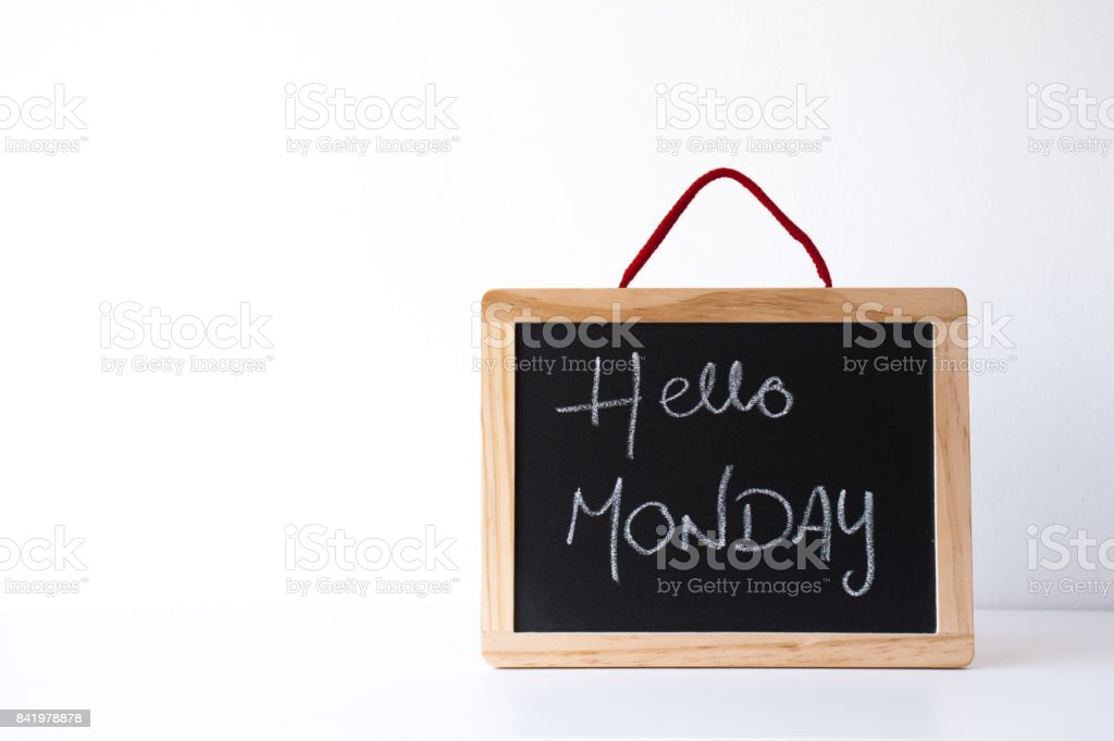 Board with text: Hello Monday stock photo