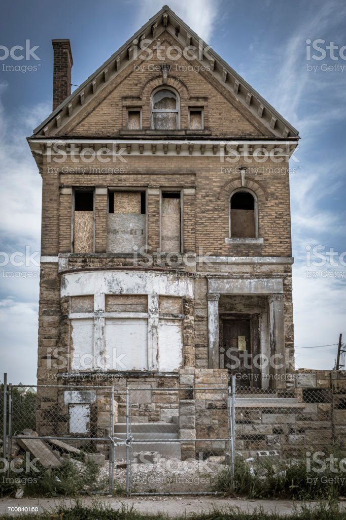 Boarded up and abandoned home stock photo