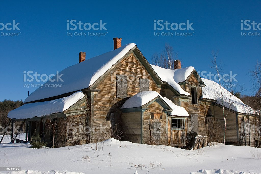 Boarded up and Abandoned House in Winter stock photo
