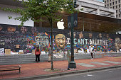 istock Boarded Up Apple Portland Store With Protest Murals 1249328608