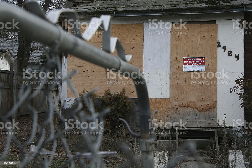 Boarded up home stock photo