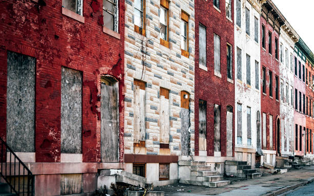 Boarded up inner city homes. West Baltimore, Maryland. stock photo