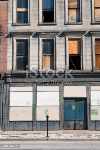 Boarded up city store front, abandoned business shut down and closed, urban decay in an old American downtown, Louisville, Kentucky, KY, USA