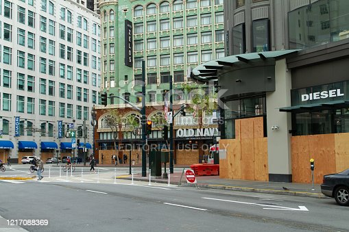 San Francisco, California - April 5th, 2020: Retail stores are boarded up in downtown during the Covid-19 pandemic.