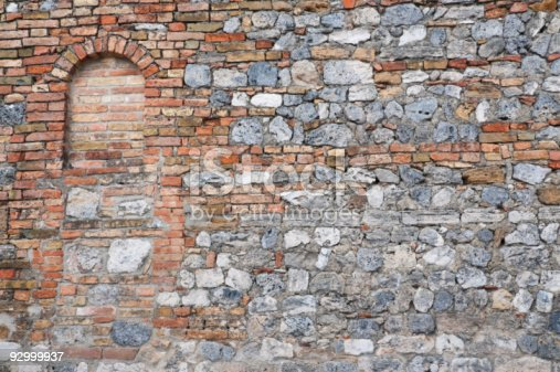 istock Boarded up window on old stone wall 92999937