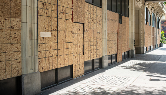 Businesses boarded up in downtown Los Angeles in preparation of riots and protestors.