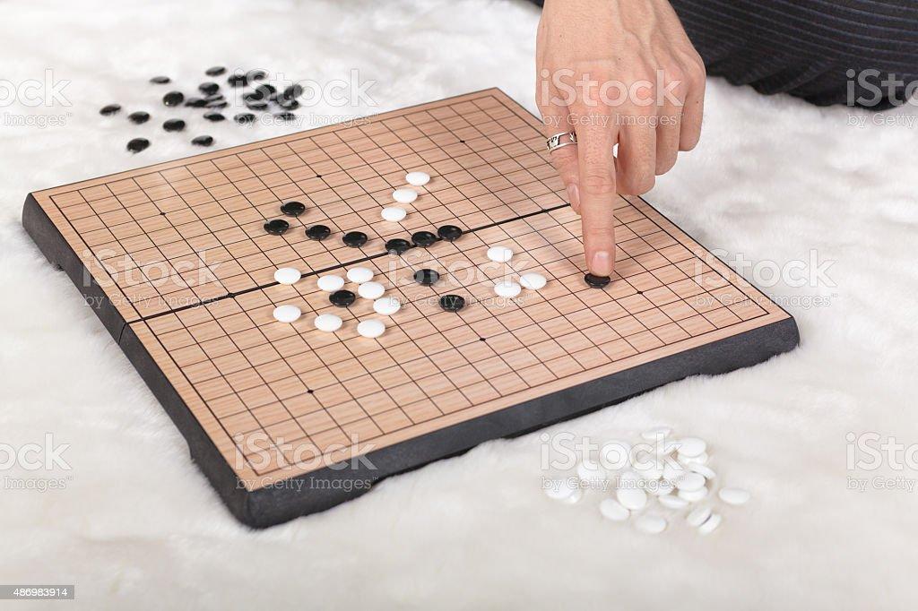 Boardgame reversi game in action stock photo