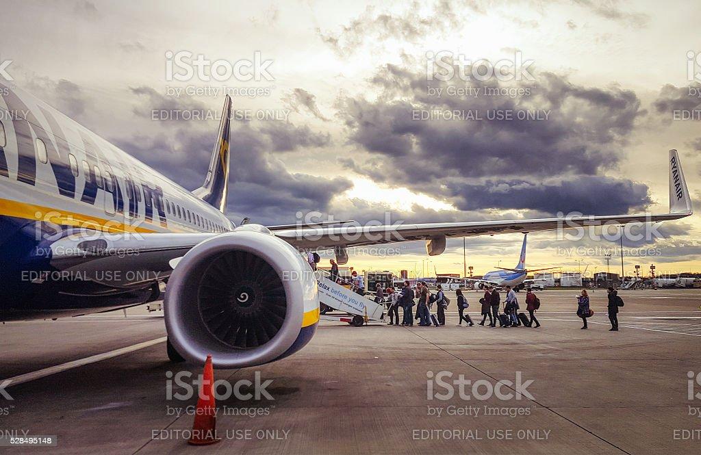 Boarding a Ryanair flight at sunset stock photo