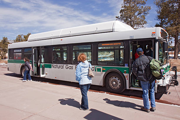 Boarding a shuttle bus at the Grand Canyon Visitor's center stock photo