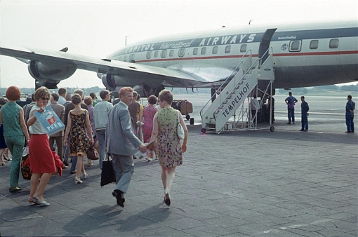 Berlin (West), Germany, 1966. Boarding at the former Tempelhof Airport. Passengers board an airplane on the Tempelhof airfield.