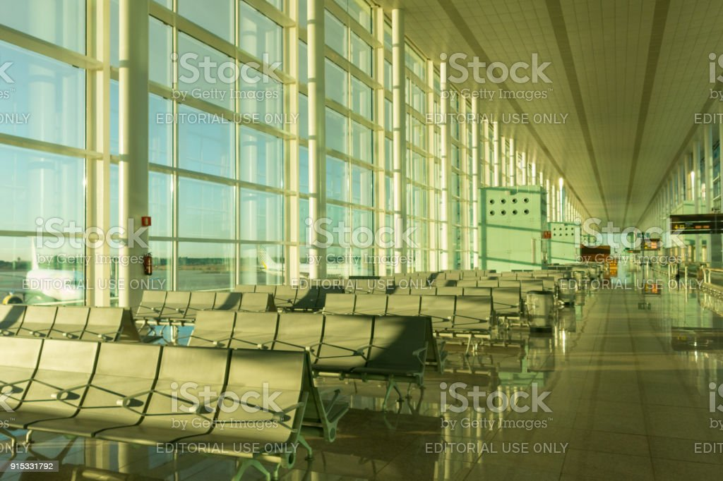 Boarding lounge in Barcelona International Airport El Prat interior . Airport is one of the biggest in Europe stock photo