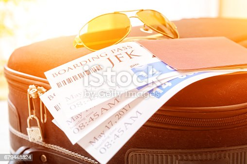istock Boarding pass tickets and luggage 679448824