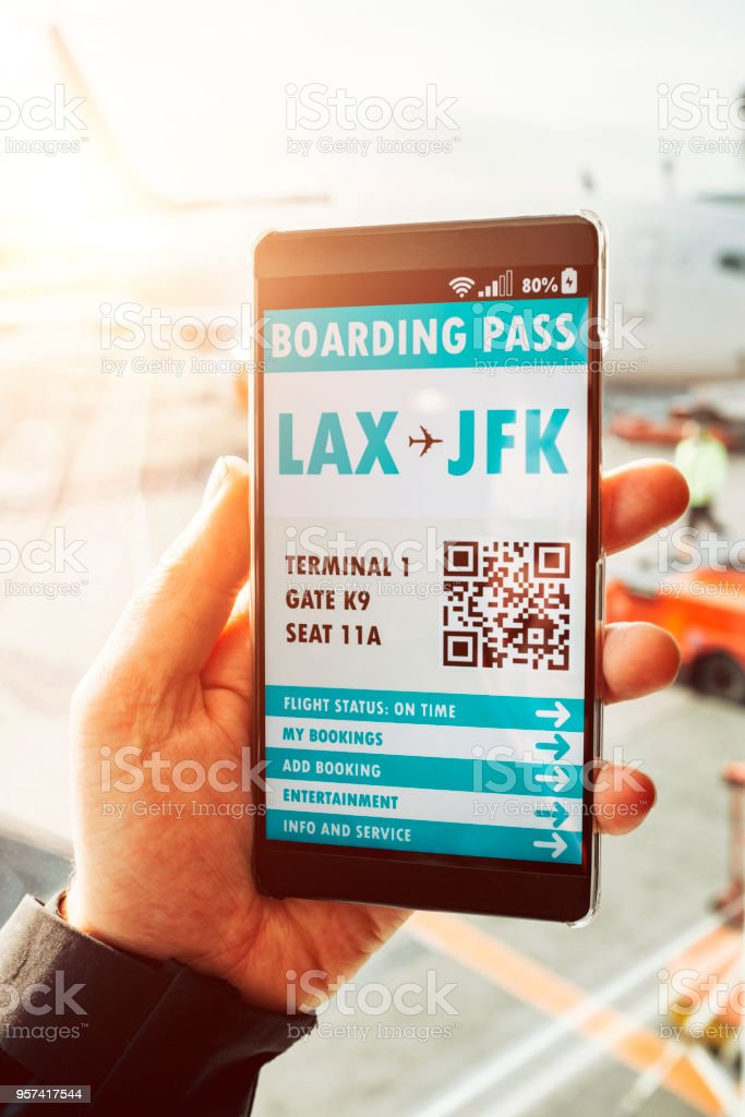 Boarding pass with QR code displayed on mobile phone stock photo