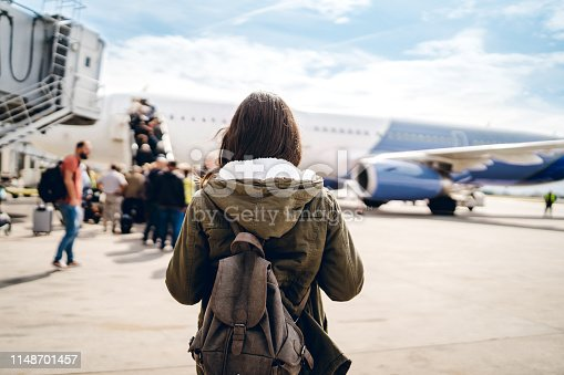 istock Boarding the plane 1148701457