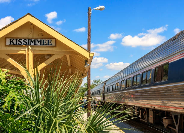 boarding the train at kissimmee station - kissimmee stock photos and pictures