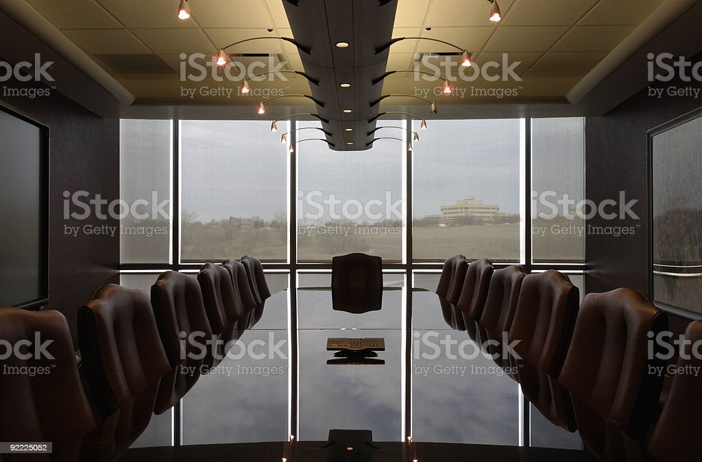 Boardroom office meeting room with reflections on table no people royalty-free stock photo