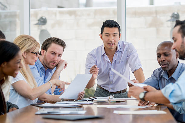 boardroom presentation - east asian ethnicity stock photos and pictures