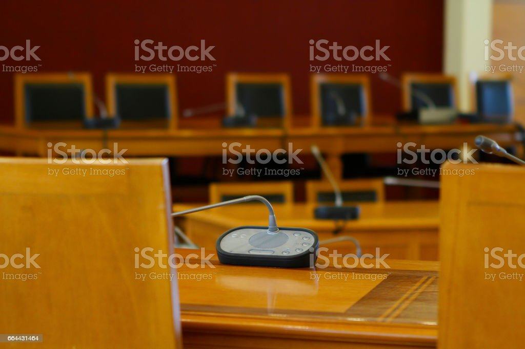 boardroom with microphones,bearings and chairs stock photo