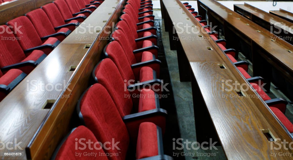 boardroom with wooden bearings and chairs stock photo