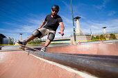 skater doing a frontside boardslide
