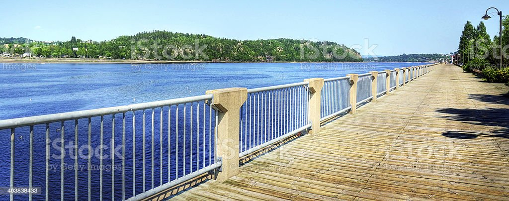 Boardwalk along the Saguenay river stock photo