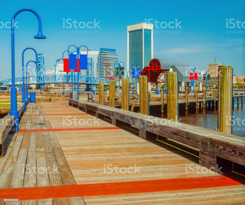 Boardwalk leads to Jacksonville, Florida and wharf (P) royalty-free stock photo