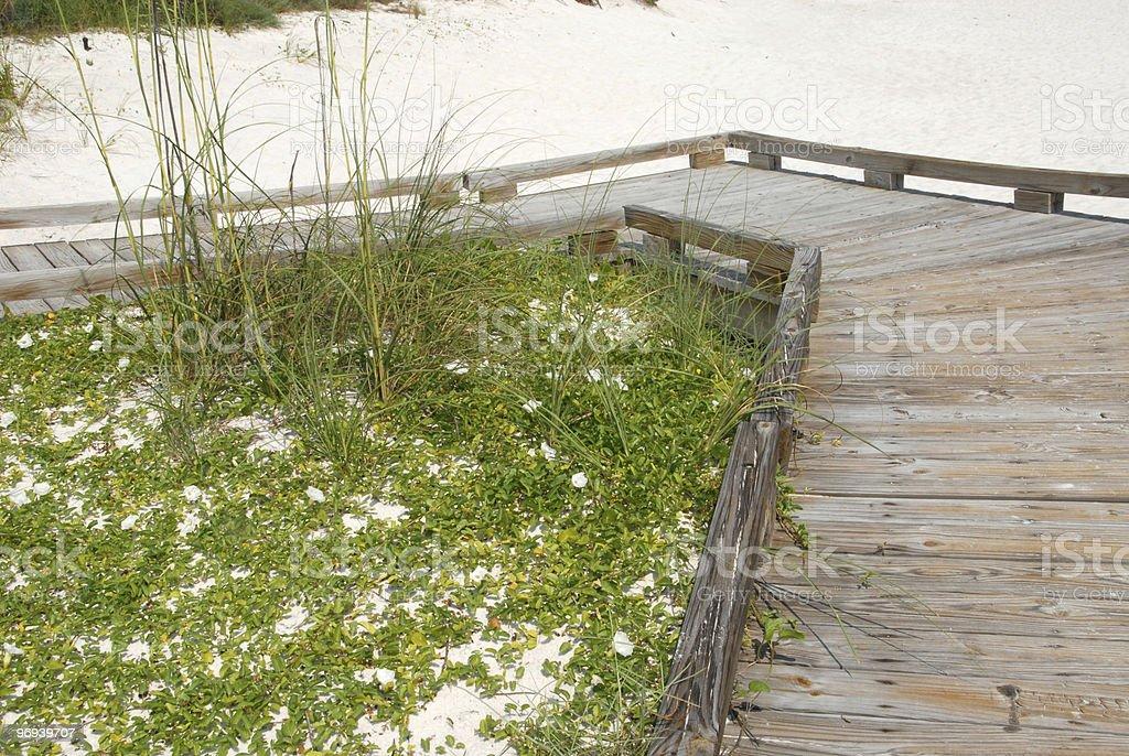 Boardwalk on white sand beach in Panama City Florida royalty-free stock photo