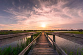 Boardwalk over the marsh in Pawleys Island in South Carolina at sunset