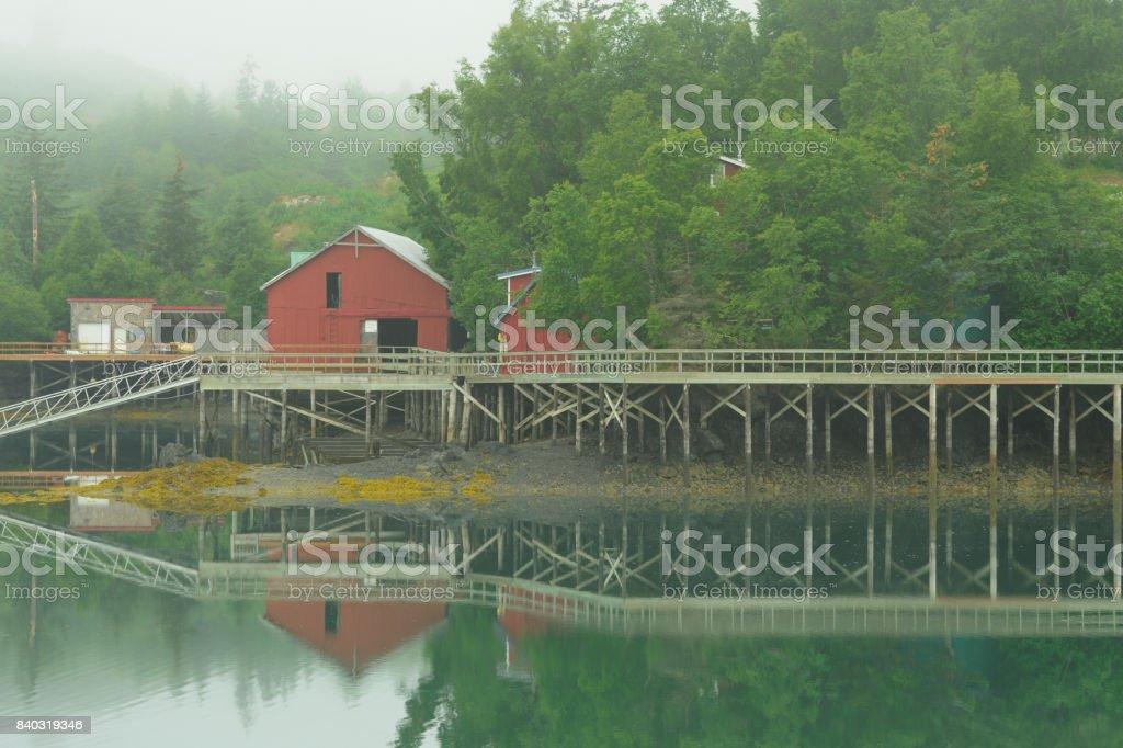 Boardwalk reflection in fog, coastal village, Alaska stock photo