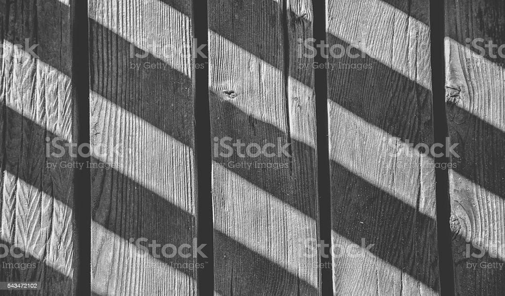 Boardwalk shadows stock photo