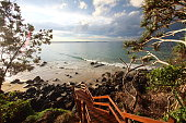 Landscape beach ocean scene with a boardwalk leading down to the secluded spot in Australia