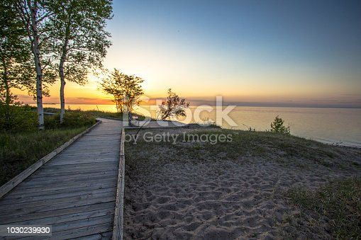 832047798 istock photo Boardwalk Sunset On Sandy Lake Superior Beach 1030239930