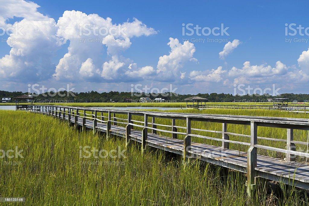 Boardwalk to Boat Dock in Salt Marsh stock photo