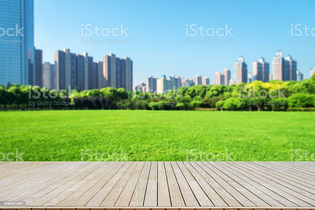 Boardwalk with city park defocused abstract background stock photo