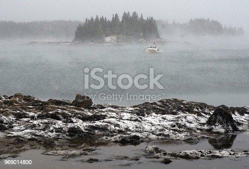 A boat in Vinalhaven, Maine Coastline in winter