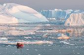 istock Boat among iceberg in Greenland 505214064
