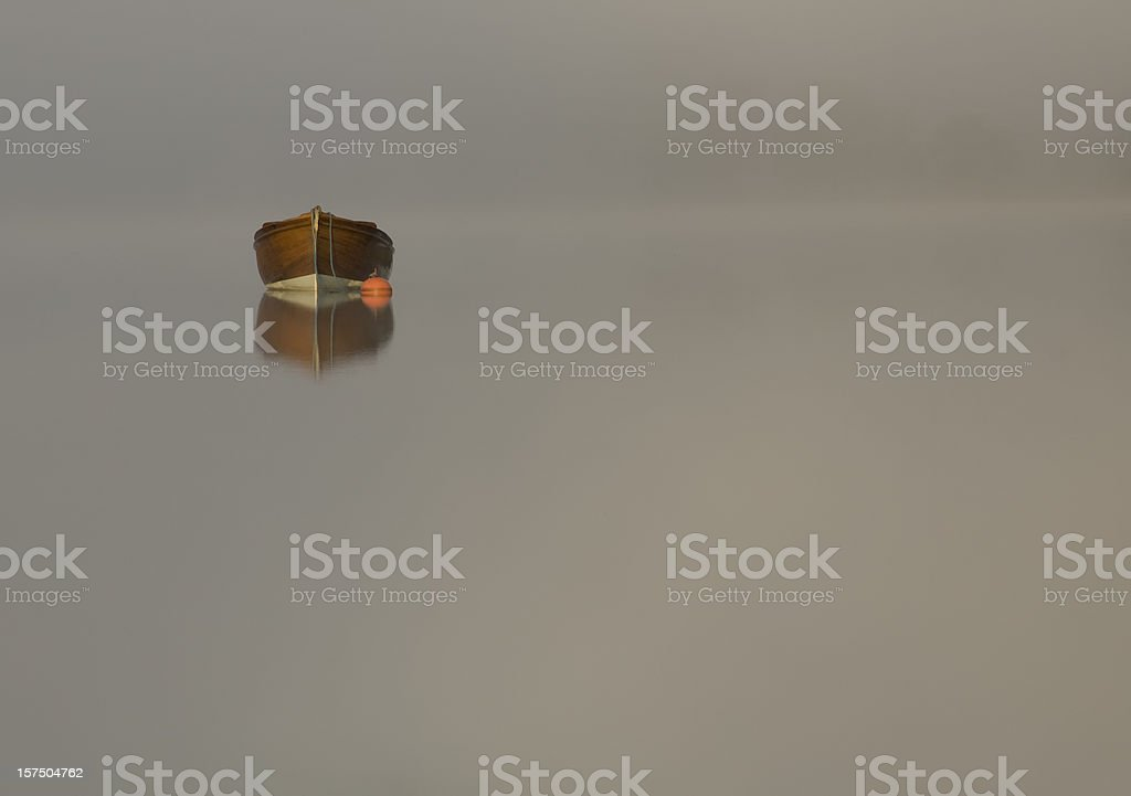Boat amongst the mist on Scottish Loch royalty-free stock photo