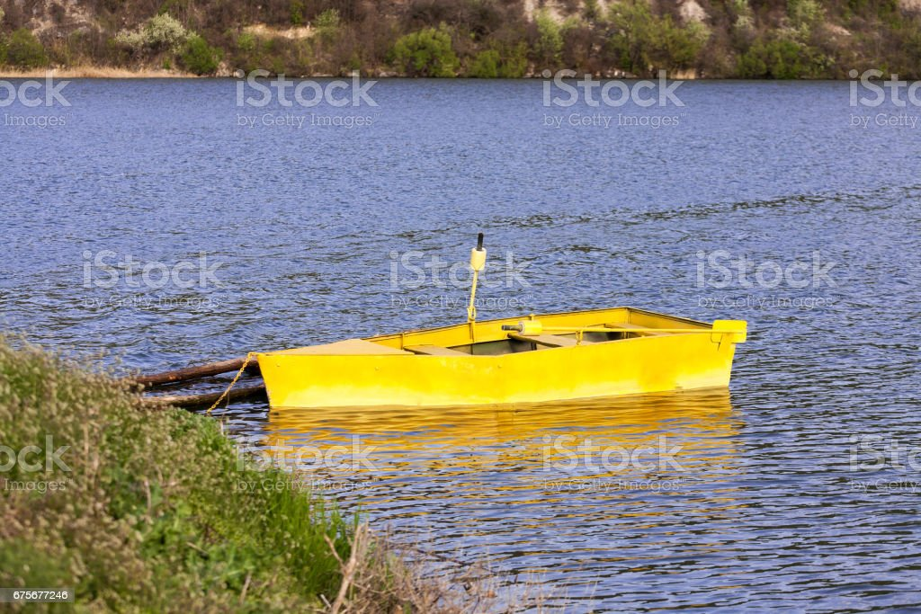 Boat anchored to the bank royalty-free stock photo
