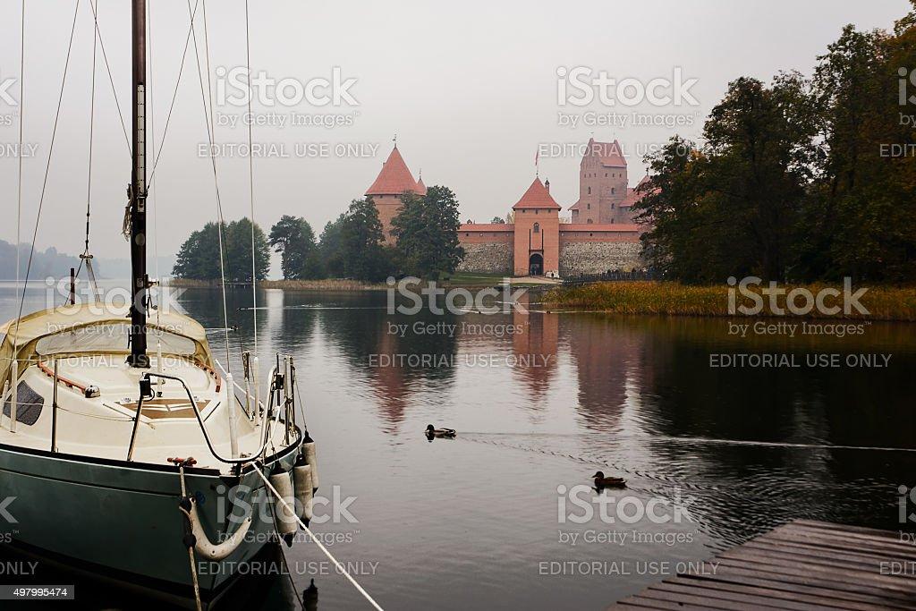 Boat and castle in Trakai stock photo