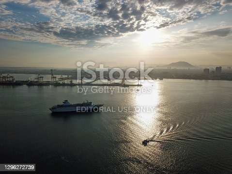 Georgetown, Penang/Malaysia - Feb 28 2020: Boat and cruise ship at sea near container terminal Butterworth.