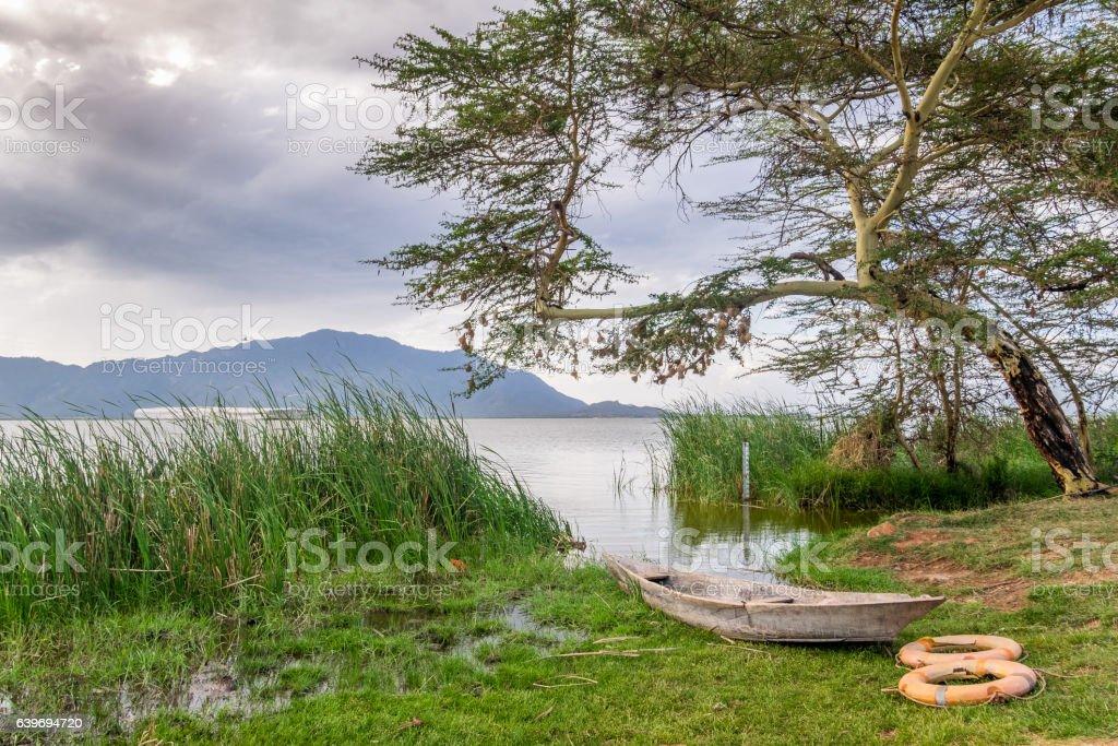 Boat and Lake Jipe at sunset, Kenya stock photo