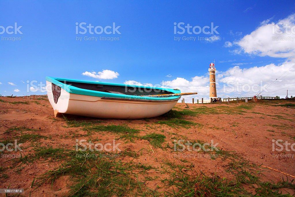 Boat and lighthouse (Jose Inacio -  Punta Del Este) stock photo
