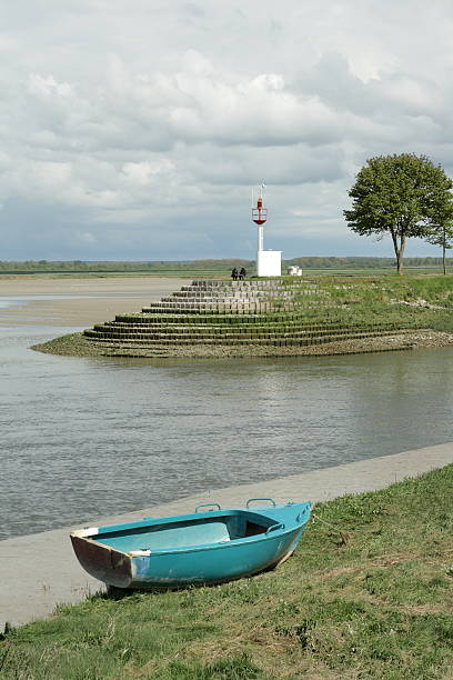 boat and lighthouse boat and lighthouse in Saint-valery-sur-somme,Somme,Picardy region of France aisne stock pictures, royalty-free photos & images