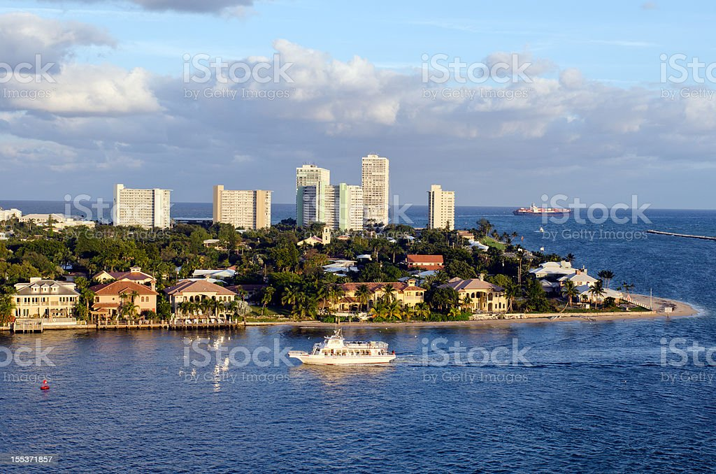 Boat and luxury beach homes at Ford Lauderdale royalty-free stock photo
