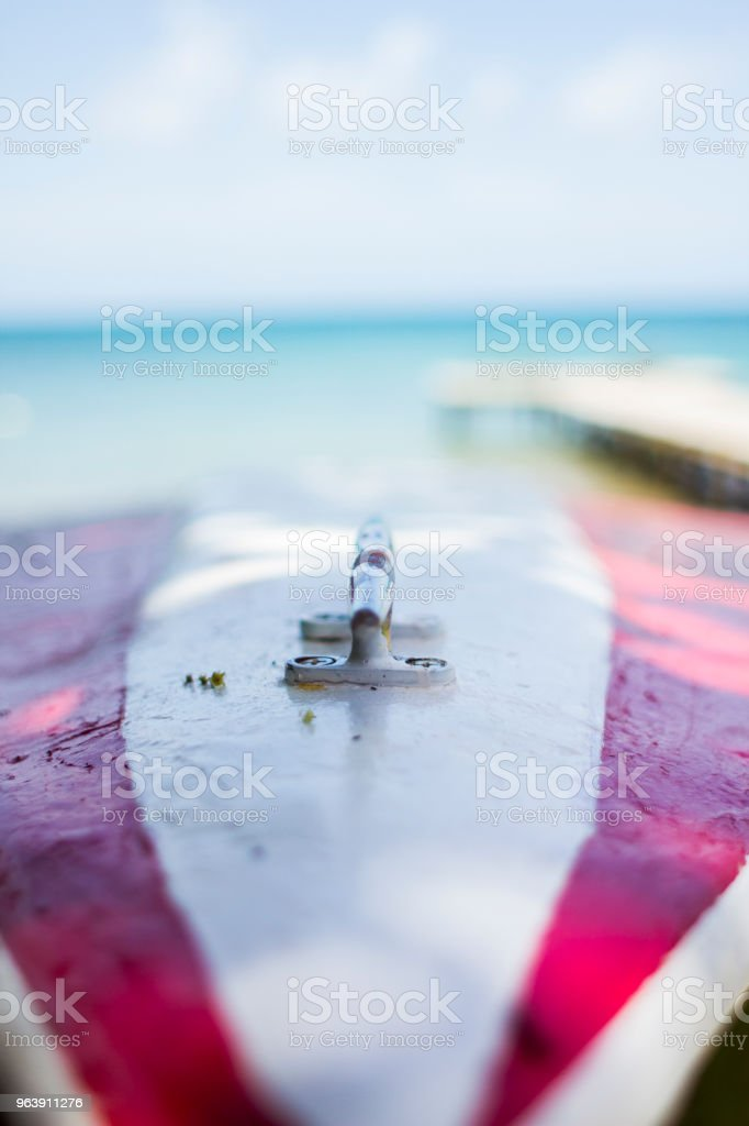 Boat and pier in front of ocean stock photo