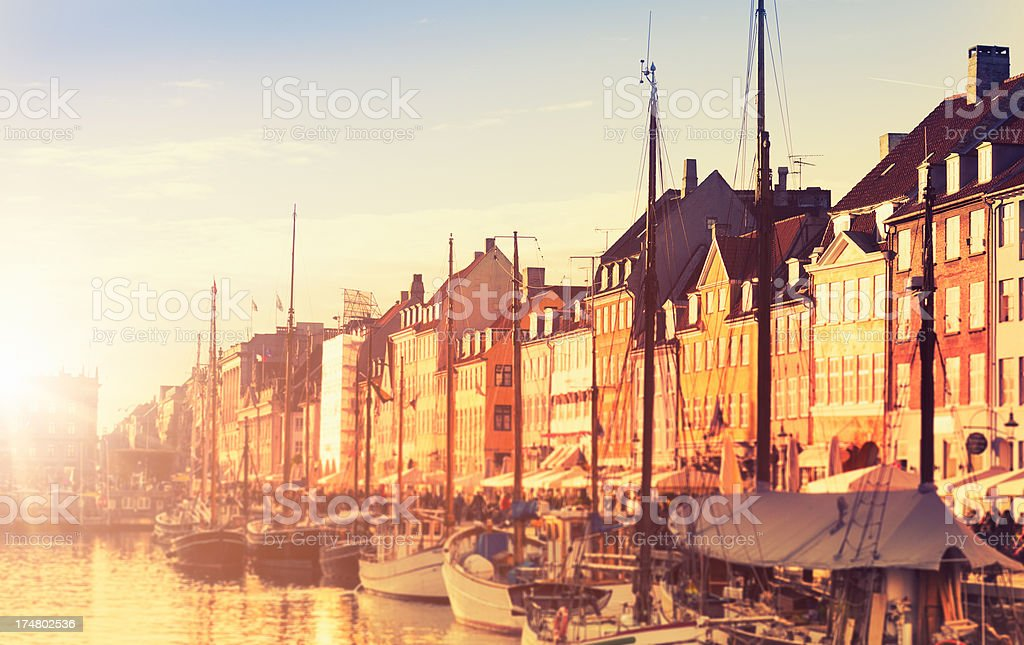 Boat and Tourist on the Nyhavn harbour in Copenhagen stock photo