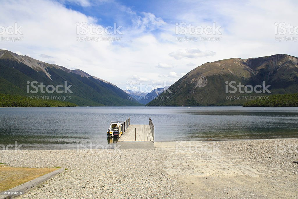 Boat at Jetty in Beautiful Lake Rotoiti, Nelson, New Zealand stock photo