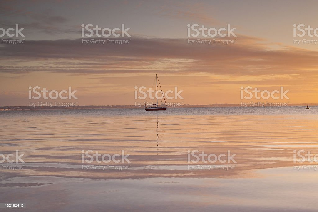 Boat at sunrise stock photo