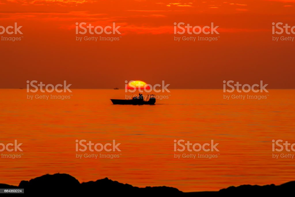 Boat at sunset stock photo