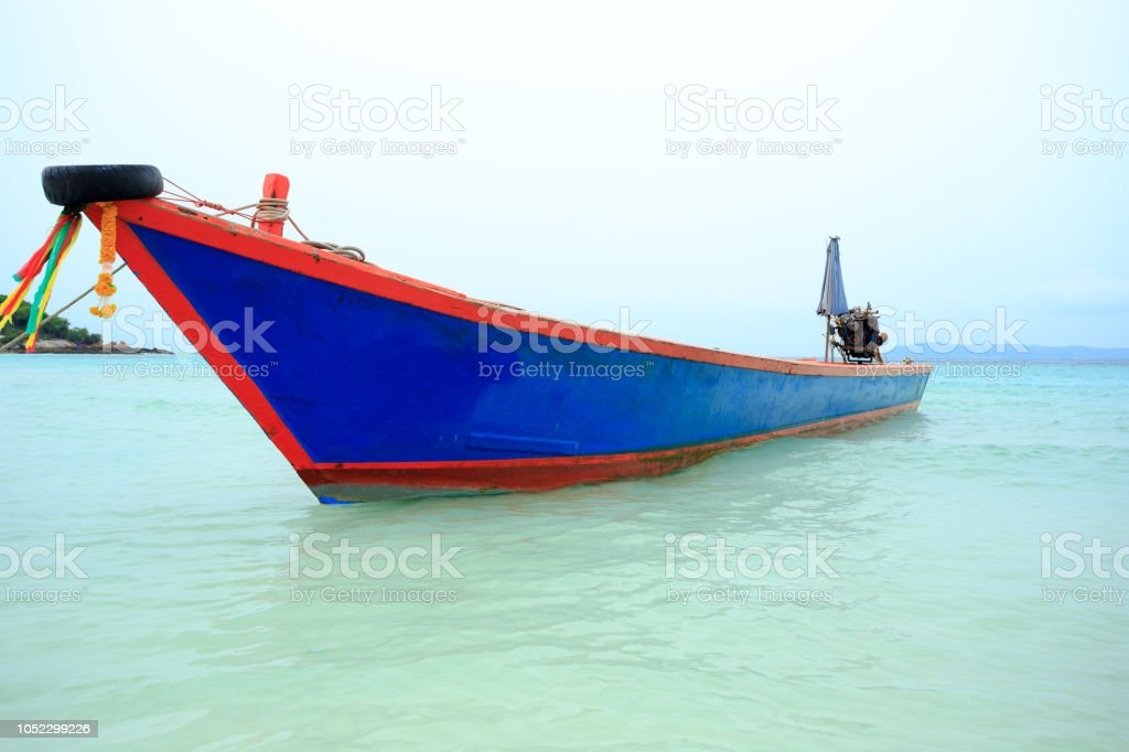 Boat at tropical beach, Thailand stock photo